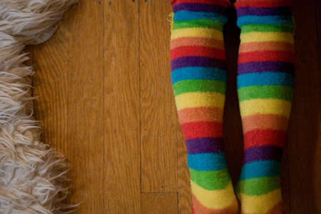 floor covering: Young girl wearing stripey tights