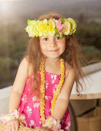 Girl wearing flower garland in hair LANG_EVOIMAGES