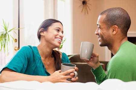 Couple relaxing with hot drink