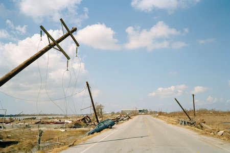 Fallen telephone poles and crashed car,aftermath of Hurricane Katrina,Cameron,Louisiana. USA LANG_EVOIMAGES