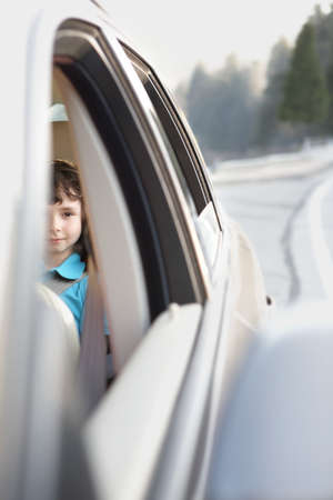 sayings: Boy sitting in the back seat of a car