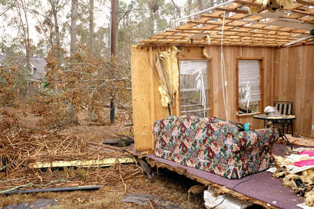 Walls and ceiling of house blown away,exposing living room,aftermath of Hurricane Katrina,Sulphur,USA LANG_EVOIMAGES