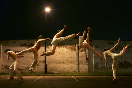entertaining area: Multiple exposure of young male free jumping in car park LANG_EVOIMAGES