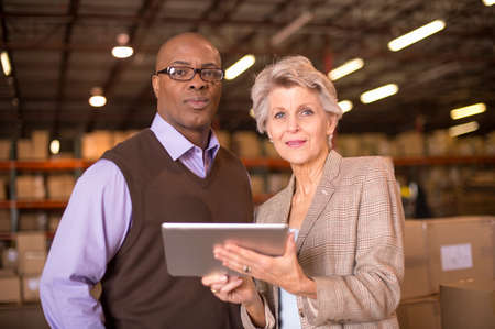 stocktaking: Warehouse managers using digital tablet