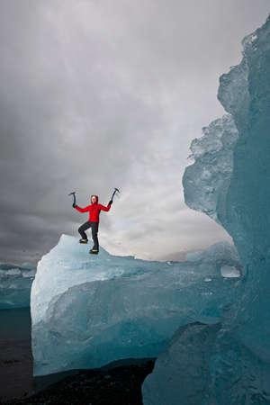 crampon: Mature woman climbing on iceberg,Jokulsa Loni,Iceland LANG_EVOIMAGES