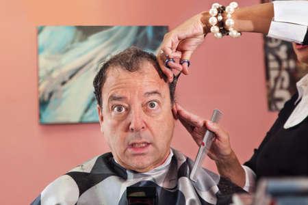 disapprove: Mature man getting a haircut