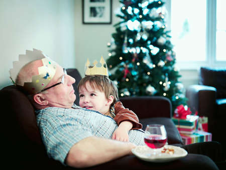 silliness: Grandson looking at grandfather asleep LANG_EVOIMAGES