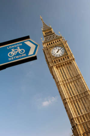 one lane road sign: Big Ben and a cycling public information sign in London,UK