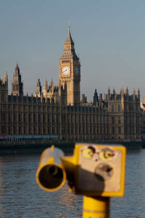Big Ben and the Houses of Parliament on the River Thames with tourist telescope,London,UK