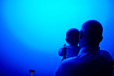 impressed: Father and son watching jellyfish at aquarium
