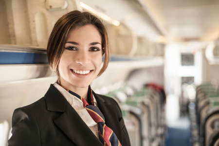 Portrait of air stewardess on aeroplane LANG_EVOIMAGES