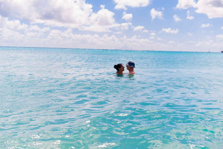 Couple in sea,St Maarten,Netherlands LANG_EVOIMAGES