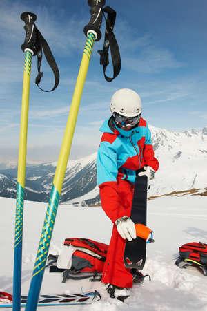 Skier preparing equipment,Kuhtai,Austria LANG_EVOIMAGES