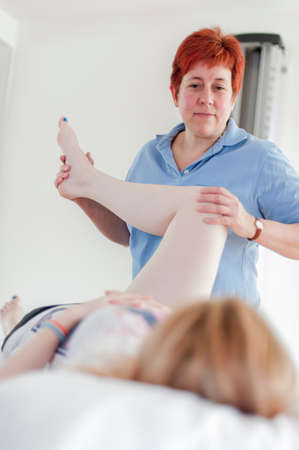 physio: Woman giving physio treatment LANG_EVOIMAGES