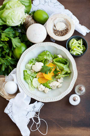 Fresh salad with cauliflower,apricots and lettuce