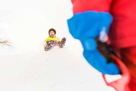 Boy sledging downhill