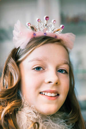 front facing: Portrait of teenage girl wearing tiara and smiling LANG_EVOIMAGES