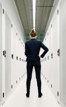 One employee standing in data storage room LANG_EVOIMAGES