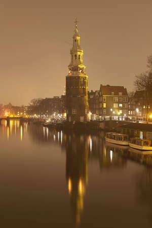 traditionally dutch: Montelbaanstoren on Oudeschans,Amsterdam,Netherlands