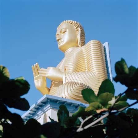 Statue of a Golden Buddha,Dambulla,Sri Lanka LANG_EVOIMAGES