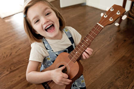 loudness: Little girl playing guitar