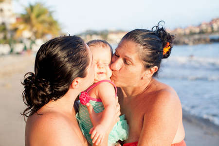 Grandmother,daughter and baby granddaughter on beach,St Maarten,Netherlands