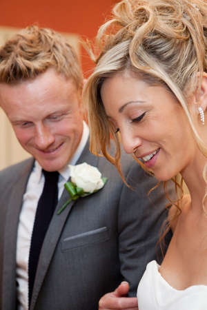 Bride and groom smiling at wedding ceremony LANG_EVOIMAGES