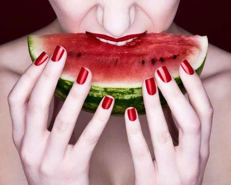 18 20 years: Woman biting slice of watermelon