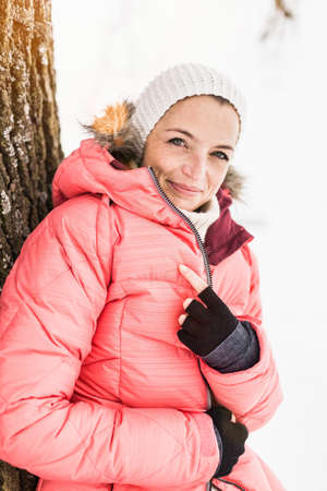 Portrait of woman wearing pink ski jacket