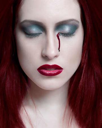 nightmarish: Portrait of young woman with eye bleeding