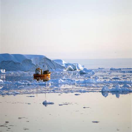 Fishing boat in icy waters,Disko Bay,Greenland