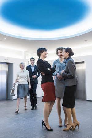 Businesspeople having conversation in atrium