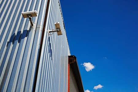 Surveillance camera on corner of industrial building