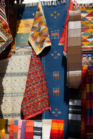 floor covering: Textiles for sale at a shop in the medina of Essaouira in Morocco
