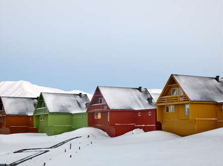 Colourful houses line the streets of Longyearbyen,the largest settlement in the Svalbard archipelago in the Arctic Circle,in Spitsbergen,Norway