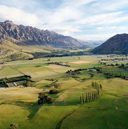 farmyards: View across farmland towards Southern Alps from helicopter,Queenstown,Southern Alps,South Island,New Zealand LANG_EVOIMAGES