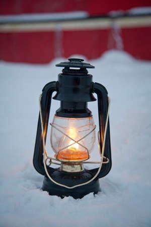 An oil lantern lit near the Noorderlicht,a Dutch Schooner. Each year the Nooderlicht is frozen into the ice in Spitsbergen