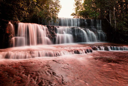 The colourful Jaspe Falls. Water erosion over thousands of years has worn the river bed,exposing the bright red mineral Jasper underneath in Venezuela