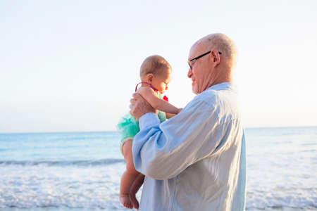 grampa: Grandfather holding granddaughter,St Maarten,Netherlands LANG_EVOIMAGES