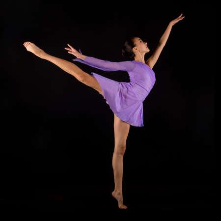 Ballerina standing on one leg LANG_EVOIMAGES