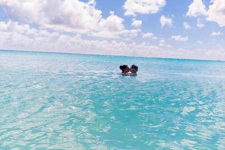 Couple in sea,St Maarten,Netherlands LANG_EVOIMAGES