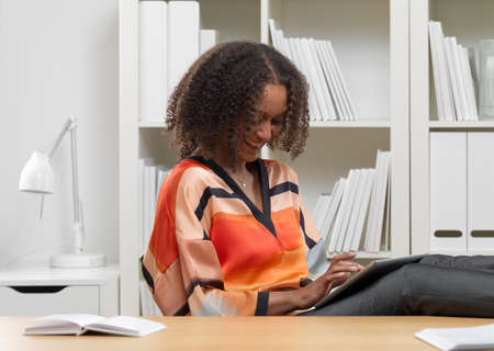 electronic commerce: Smiling businesswoman using digital tablet