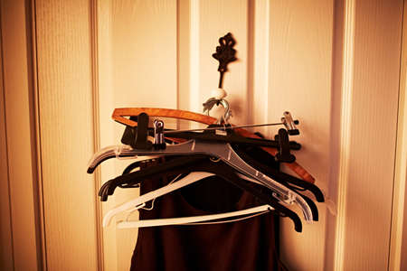 Clothes on coat hangars on hook