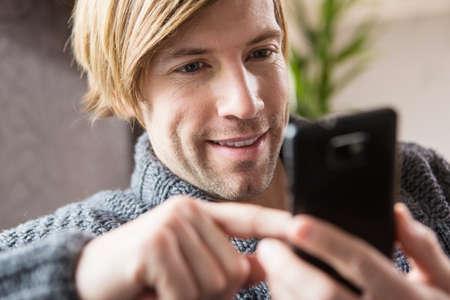 Man using smartphone,close up