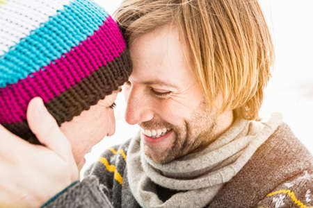 Couple face to face,woman wearing knit hat