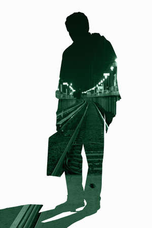 shadowed: Cut out silhouette of businessman with urban scene LANG_EVOIMAGES