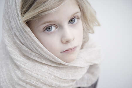 Portrait of girl wearing headscarf LANG_EVOIMAGES