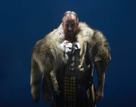 30 years old man: Studio portrait of gladiator wearing wolf fur