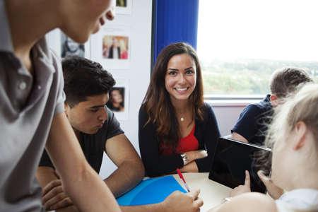 north western european descent: Teenage schoolchildren using digital tablet