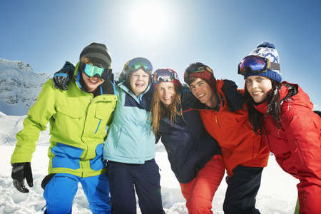 Friends wearing skiwear with arms around each other,Kuhtai,Austria